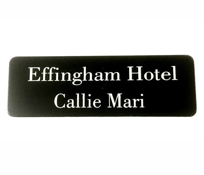 Black Name Badge with white text and pin attached Laserable Plastic 70 x 23 mm